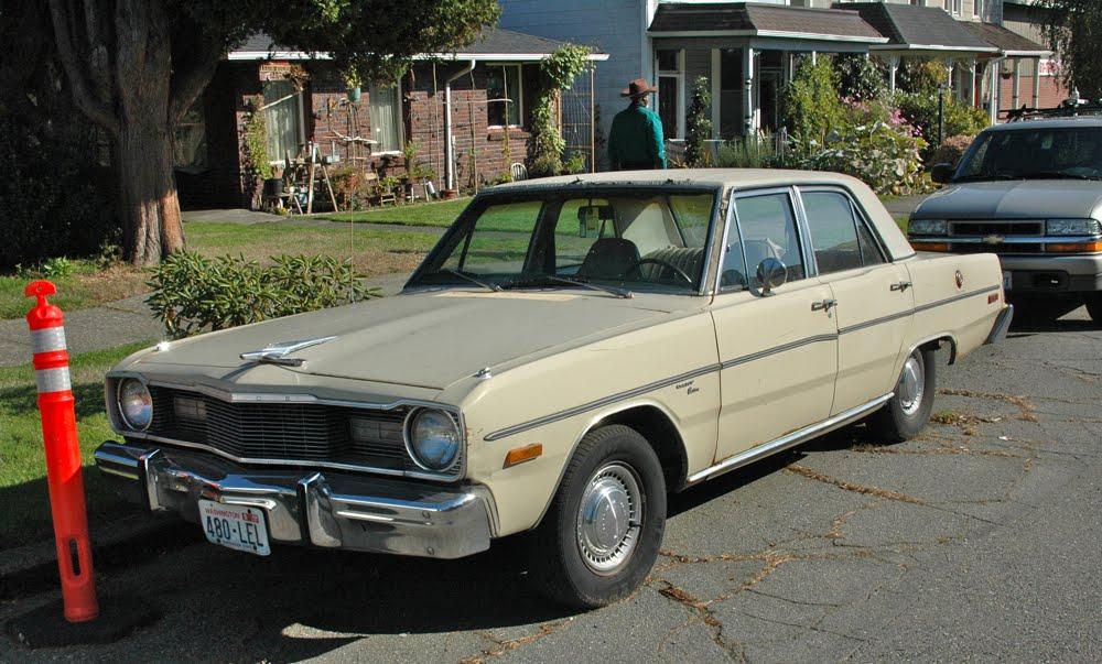 OLD PARKED CARS.: 1975 Dodge Dart Custom.
