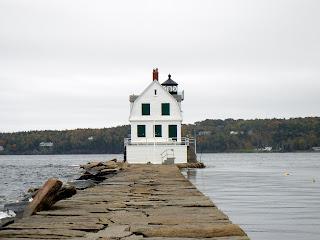 Walking on the 4,300 foot long breakwater to Breakwater Lighthouse in Rockwell, Maine