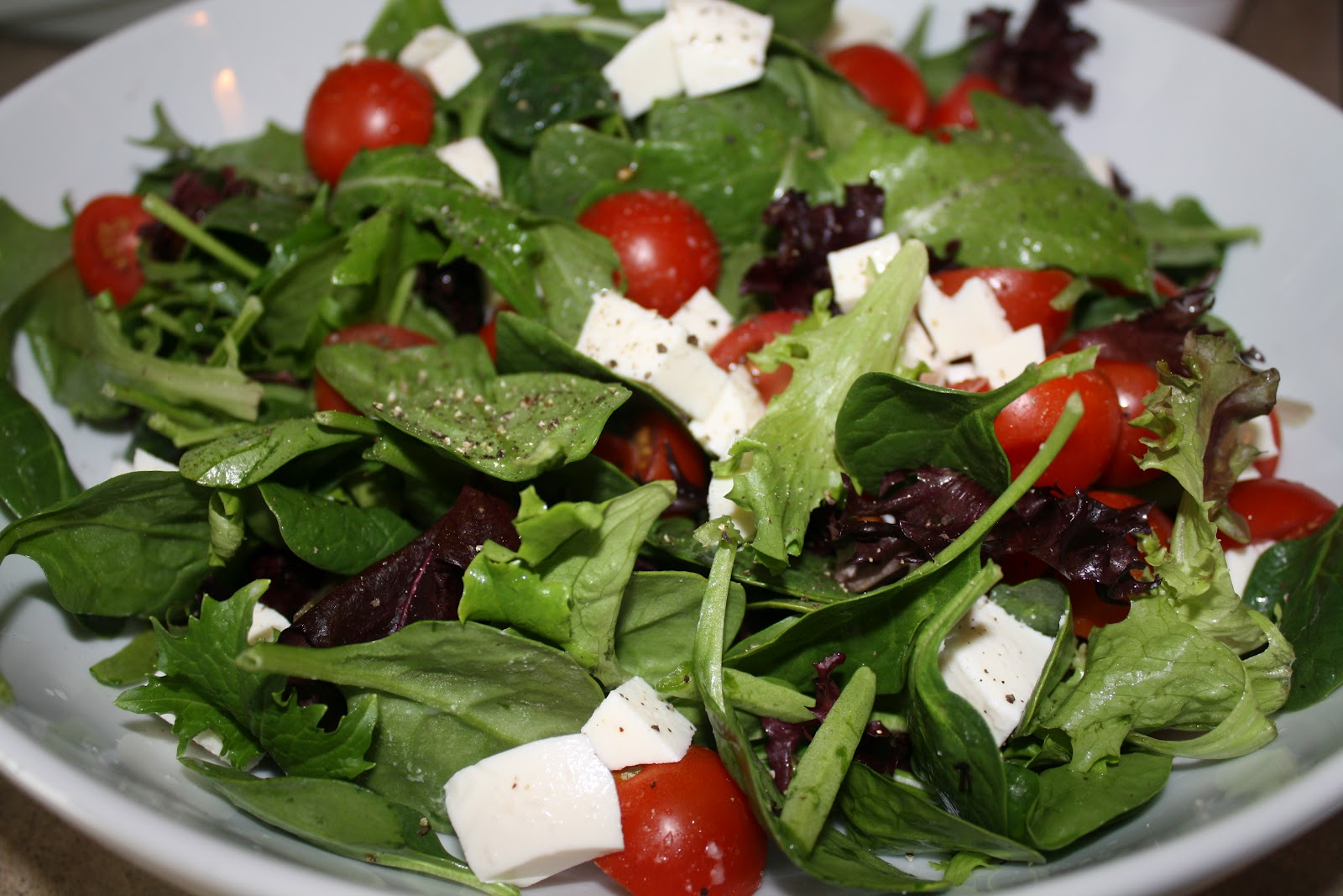 ... simple greens with tomatoes, mozzarella and basil-garlic dressing