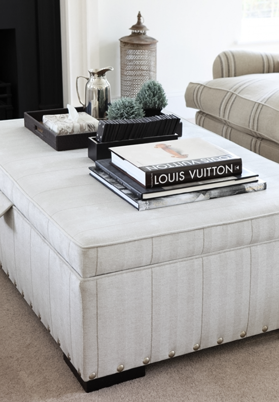 Classy ottoman coffee table vignette by Ham Interiors.