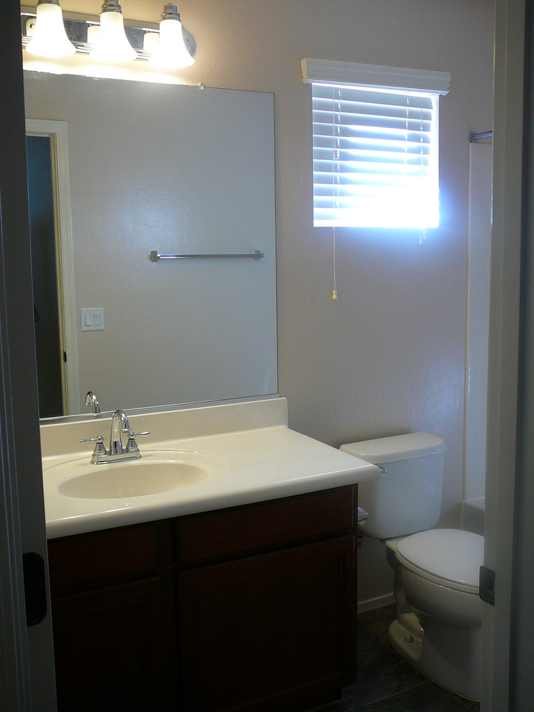 Focal point styling rental restyle small bath space for Bathroom window designs