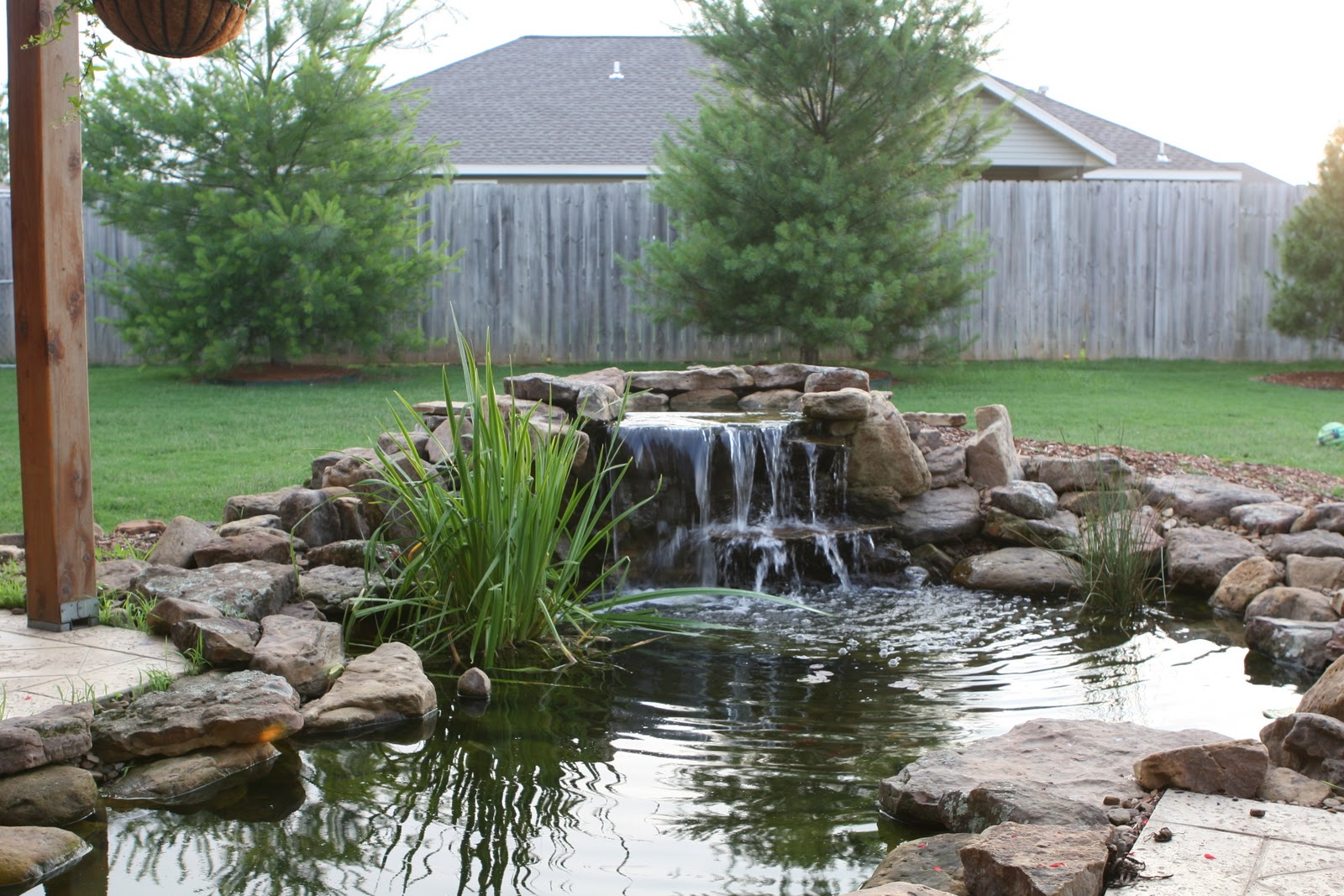 Gilberts 2501 nw 6th street bentonville for Koi pond waterfall