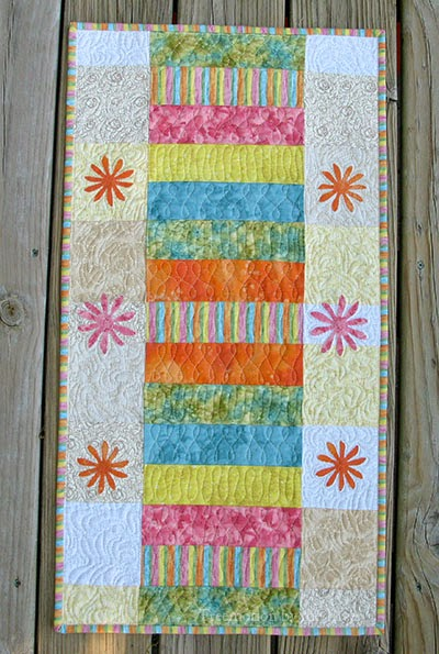 Sherbert Stripes table runner on the deck
