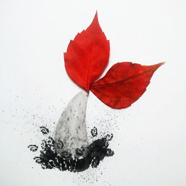Pez saltando al agua con cola de hojas secas
