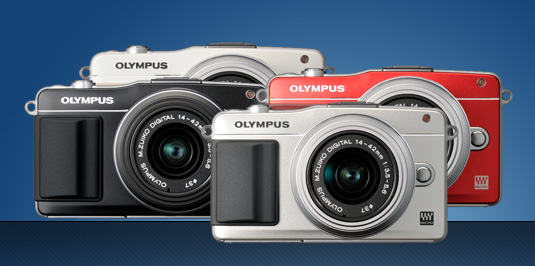 photo of all the new olympus pen epm2 digital cameras red, black, white, silver