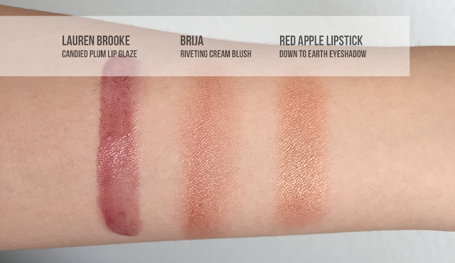 Swatches of Lauren Brooke Candied Plum Lip Glaze, Brija Riveting Cream Blush, and Red Apple Lipstick Down to Earth Eyshadow.