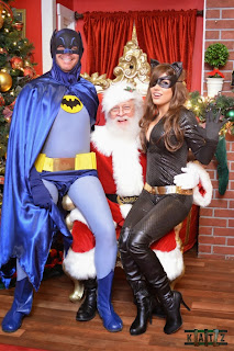 Liz Katz as Catwoman sitting on Santa's lap