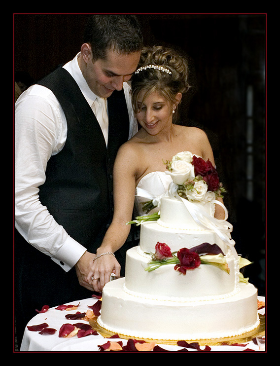 Bride And Groom Cutting The Wedding Cake Food And Drink