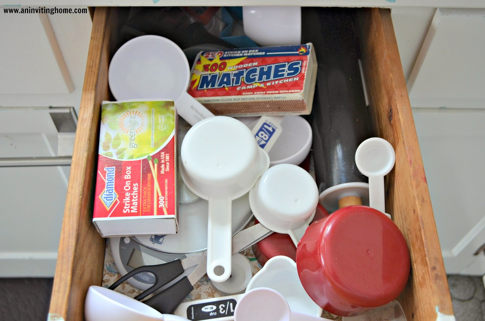 a messy kitchen drawers