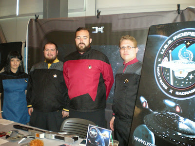Four Star Trek fans dressed in Starfleet costumes.