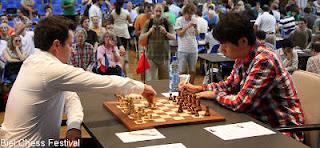 Echecs ronde 6 : Etienne Bacrot (2713) 1/2 Wang Hao (2739) © site officiel