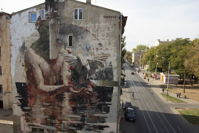 Our friend Borondo is currently in Poland where he just finished working on a massive new piece somewhere on the streets of Lodz.