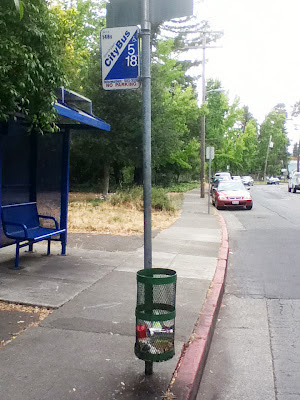 Trash can attached to CityBus pole in Santa Rosa