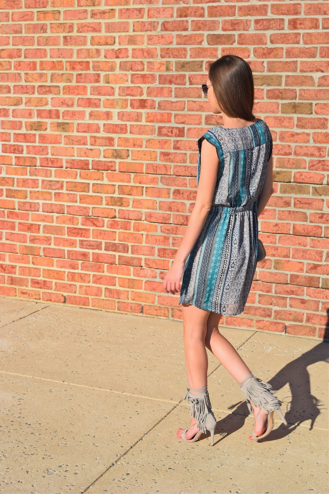 Wearing forever21 abstract tunic dress, wearing Schutz Shoes Kija Fringe heels