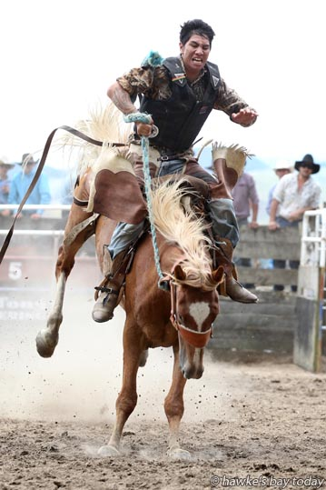 Roany-lane Waru competes in the second division saddle bronco event at the Upper Mohaka Rodeo, at the Upper Mohaka Domain. photograph