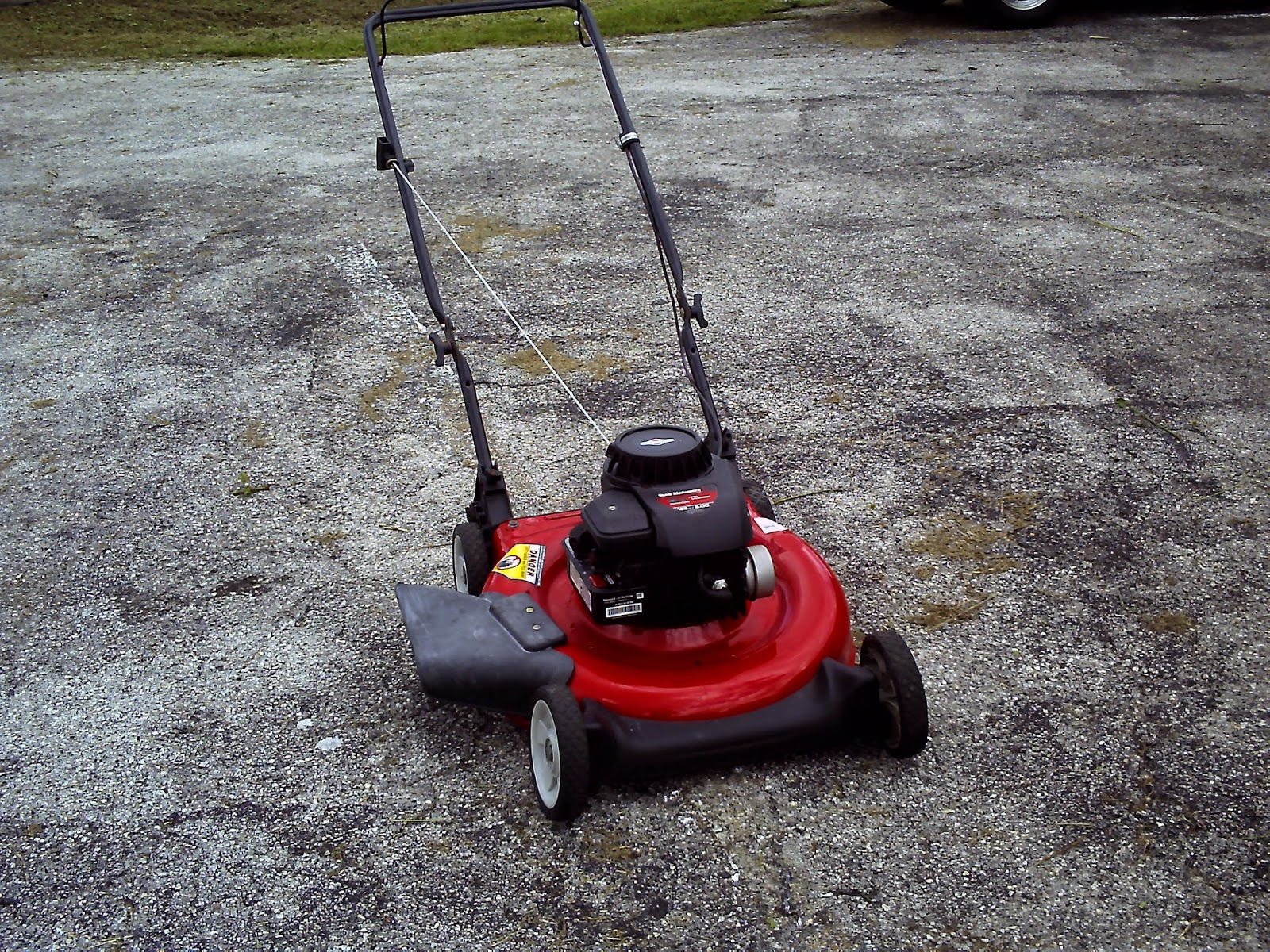 """MTD 21"""" PUSH MOWER .... REBUILT AND RESORED TO IT'S FORMER GLORY... HAS A  BRIGGS & STRATTON ENGINE WITH 5 HORSES TO BACK IT UP... EXCELLENT  RUNNING/WORKING ..."""