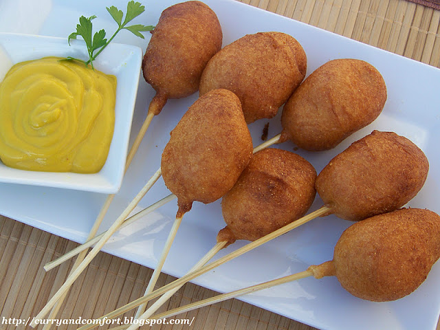 Place the corn dog into the hot oil around 350 degrees fry until