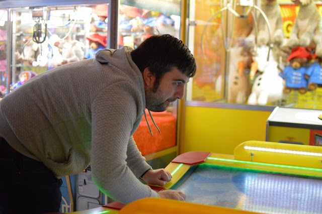 Man playing air hockey