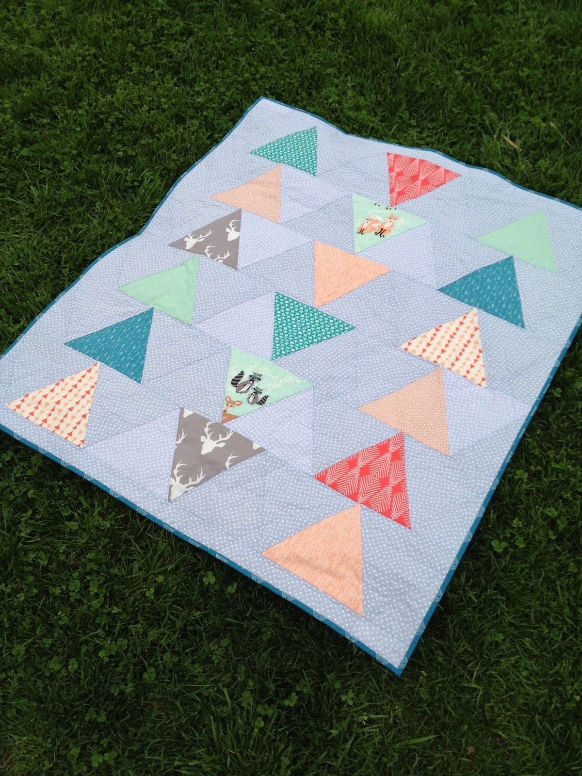 http://ablueskykindoflife.blogspot.com/2015/04/into-woods-baby-quilt.html