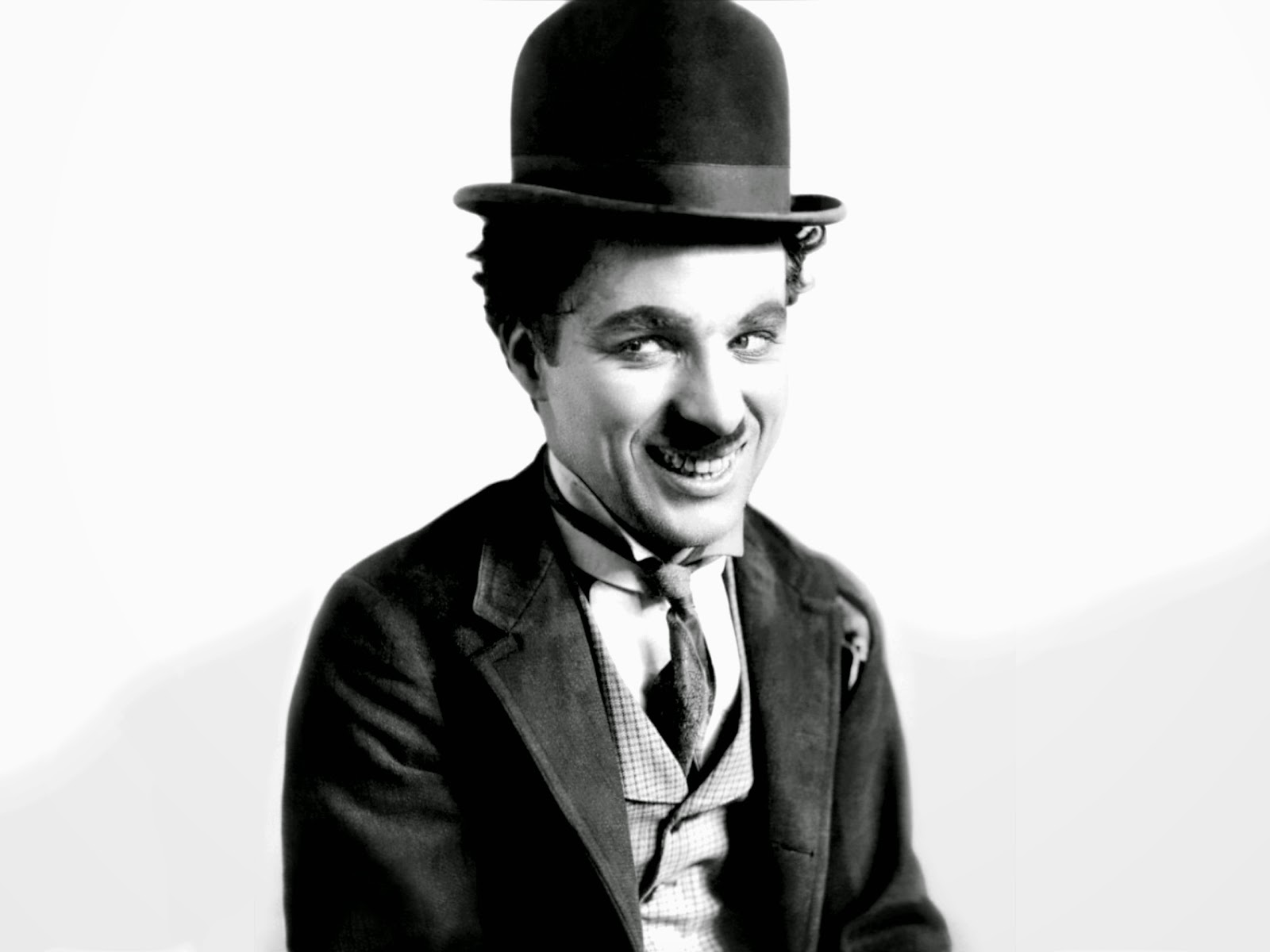 Help I have to write a essay on Charlie chaplin best answer gets 10 points!!!?