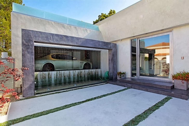Glass garage wall on Modern Beverly Hills House with open interiors