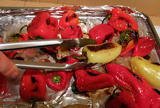 Hand with Tongs Turning Peppers