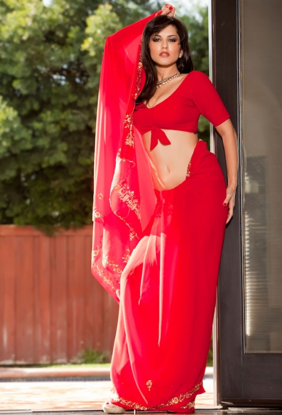 US Model Sunny Leone Photographing for Indian Fashion in a Red Indian Saree