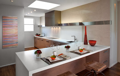 clean lines on the kitchen and dining furniture works great with pops of color