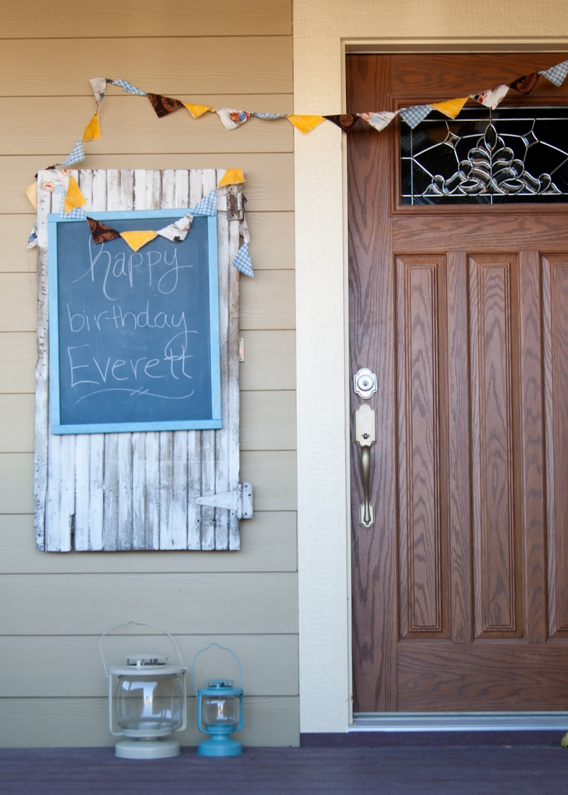 Old door, vintage chalkboard and bunting