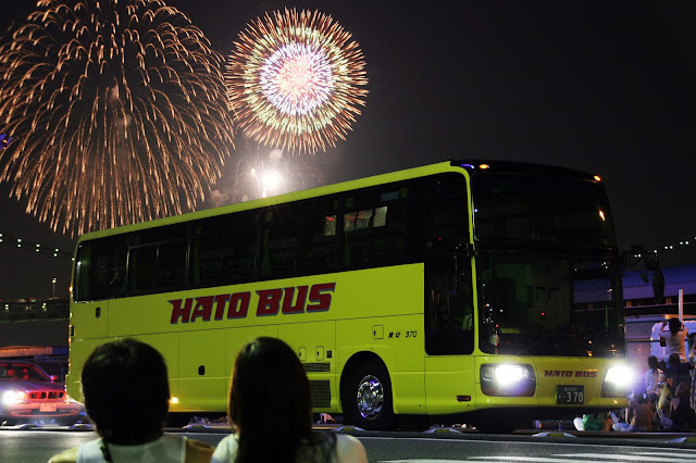Bus with fireworks exploding in background