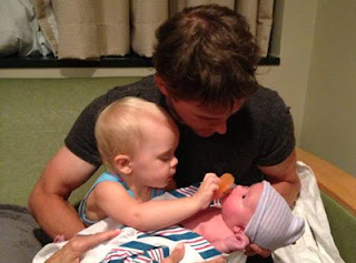 Big sister, Juliet and Dad, Scott Speed tend to Newborn Ava Maria.