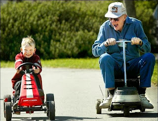 funny picture: grandchild and grandfather racing