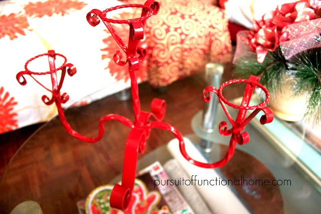 Treasure Hunting by Pursuitoffunctionalhome.com. candle holder painted in red.