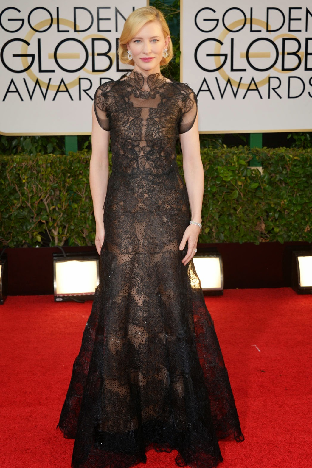 Cate Blanchett in a modest black lace gown with cap sleeves by Armani Privé