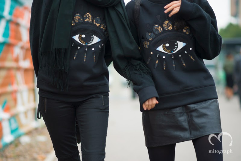 two women wear Kenzo black sweaters and attend Kenzo 2014 Spring Summer Fashion Show at Paris