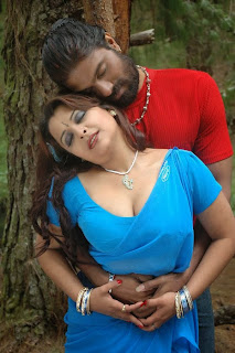 Hot B Grade Mallu Actress Showing Deep Cleavage and Boob Press While Romance