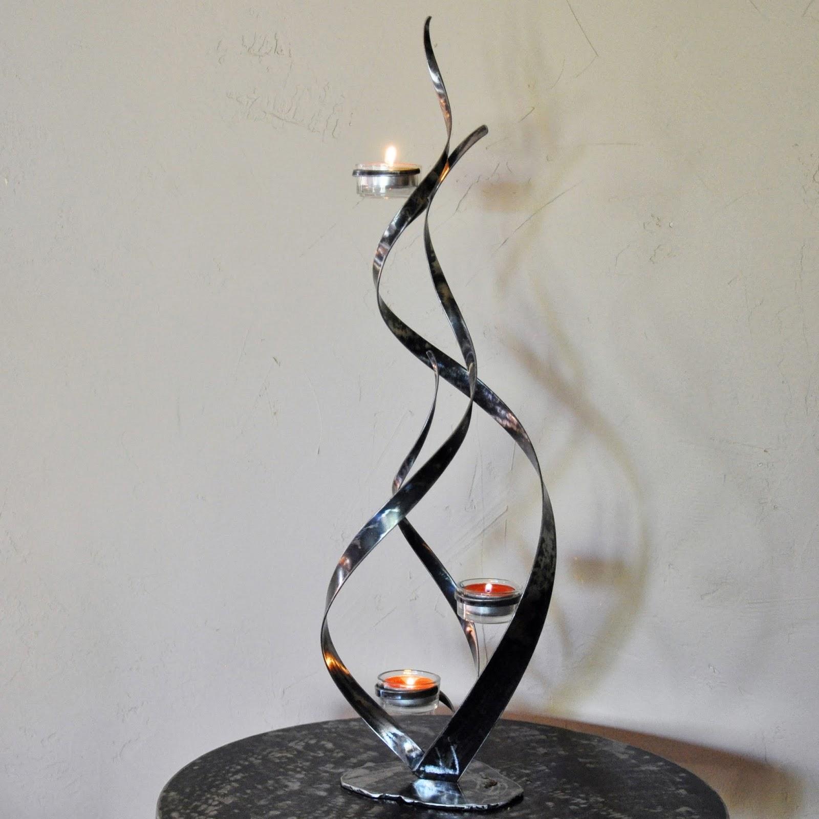cr ateur d 39 objets d co en fer forg bougeoirs luminaires porte bouteille bougeoir flamme. Black Bedroom Furniture Sets. Home Design Ideas