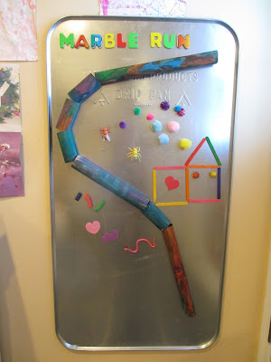 Homemade marble run and magnet board