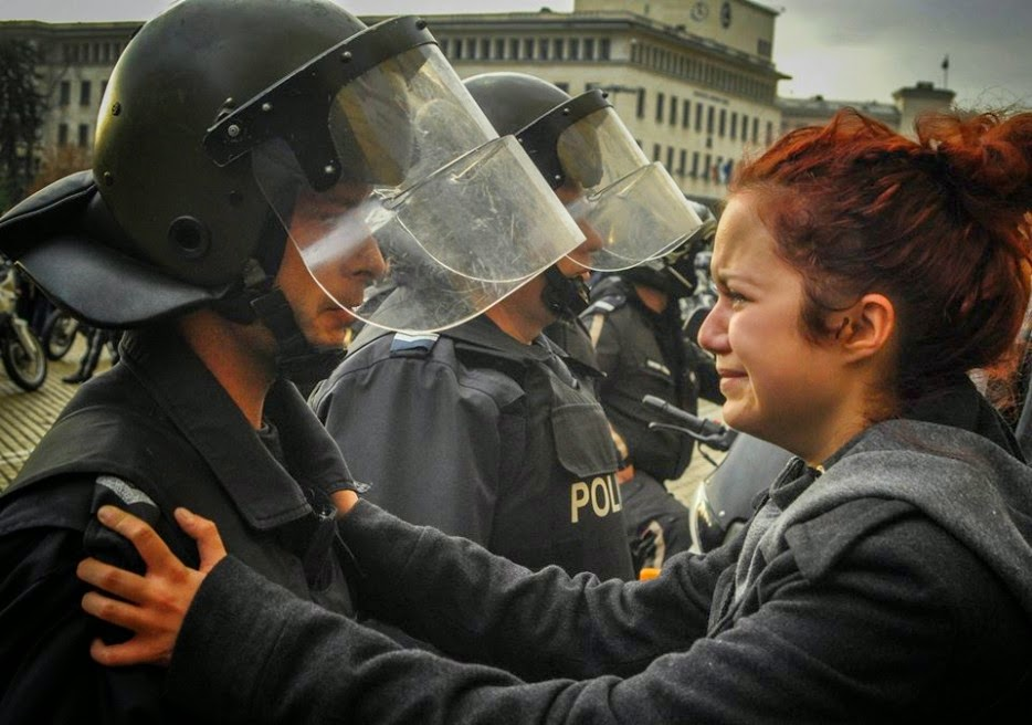 35 moments of violence that brought out incredible human compassion - riot police and protesters share a cry together