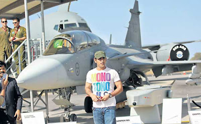 Dhoni posing with an Aircraft