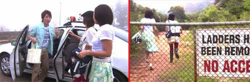 "Tsutsumi and the girls get out of the taxi. / The girls run behind a fence with a ""No Access"" sign posted."