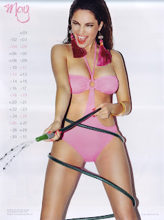 Kelly Brook in a hot pink one piece swimsuit