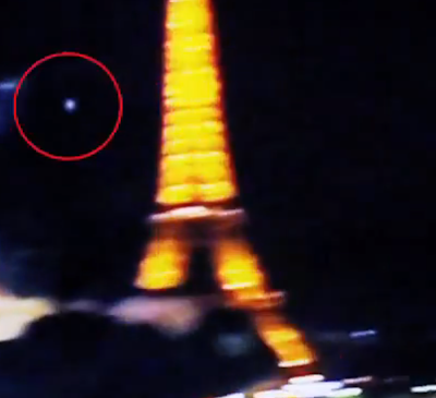 Glowing UFO Caught Hovering Close To The Eiffel Tower, UFO Sightings