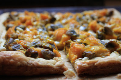 Savoury roasted squash tart with parmesan, capers and pine nuts