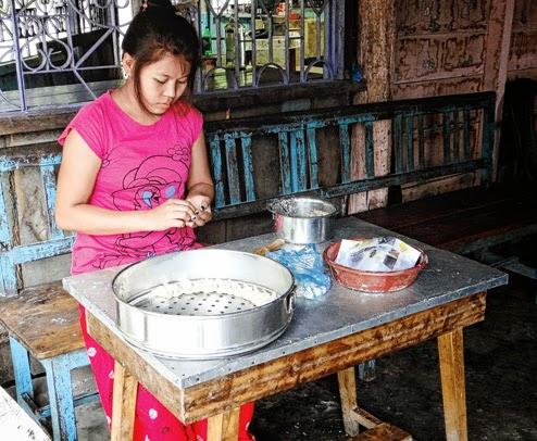 Deepa Rai prepares momos at her shop in Santlabari near Alipurduar  on Wednesday