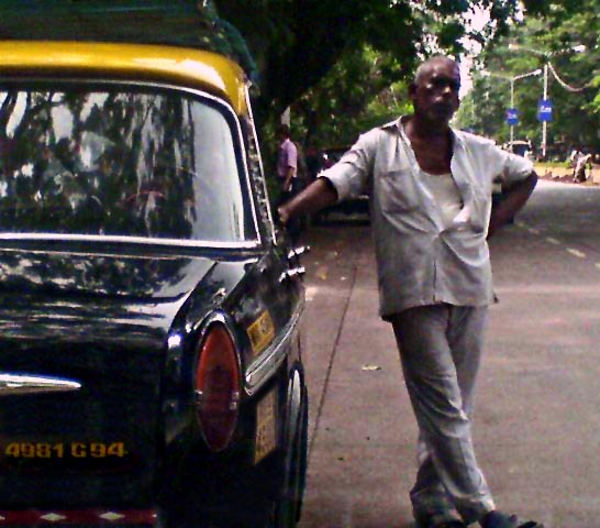 taxi driver standing near taxi
