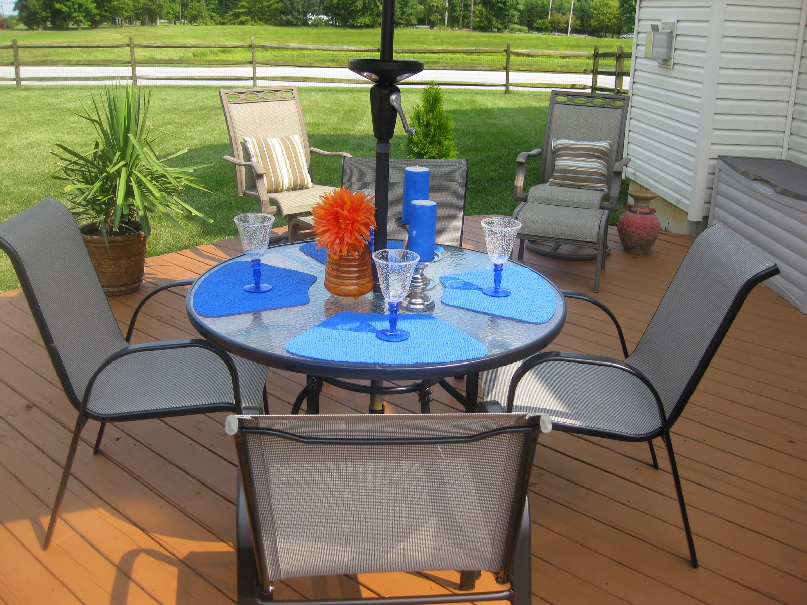 Patio table setting and decor - orange and blue