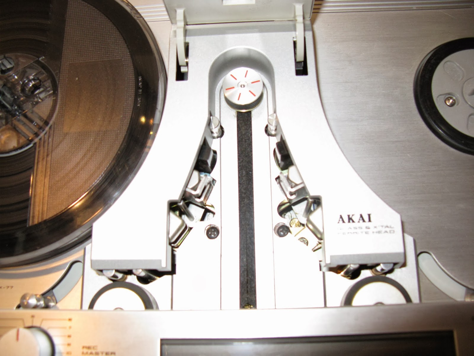 "Akai GX-77 7"" Reel to Reel Head assembly close up."