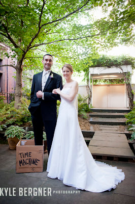 Bride and Groom in garden with Time Machine