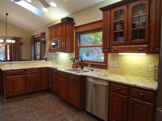 cherry kitchen cabinets with bronze hardware